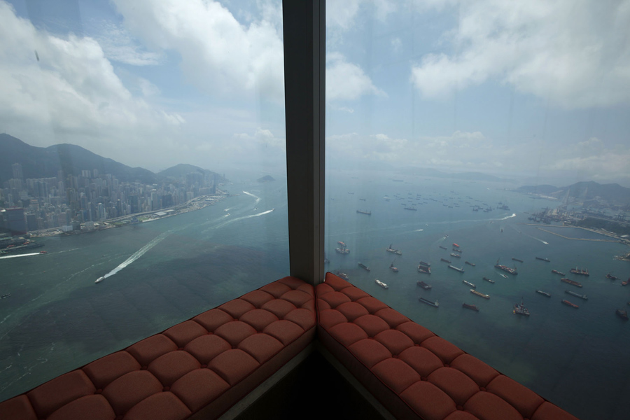 A window view overlooks the Victoria Harbour from a junior suite located on the 111th floor of the Ritz-Carlton Hotel in the International Commerce Centre (ICC), the world's fourth tallest building, in Hong Kong May 11, 2011. The hotel, which occupies floors 102 to 118 inside the ICC, staged its opening ceremony in early May, becoming the world's highest hotel. REUTERS/Bobby Yip (CHINA - Tags: BUSINESS TRAVEL SOCIETY) - RTR2M8VX