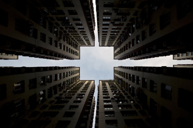 Apartment blocks form a symmetrical pattern in Hong Kong, on January 2, 2014. Home prices in the southern Chinese city have risen by 120 percent since 2008, and by more than 30 per cent from their previous peak in 1997, with prices in the luxury market being pushed up by wealthy buyers from mainland China. AFP PHOTO / ALEX OGLE (Photo credit should read Alex Ogle/AFP/Getty Images)