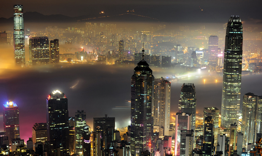 AFP PICTURE OF THE YEAR 2010 A layer of fog floats into Victoria harbour in Hong Kong late on March 15, 2010. Warm humid air from the south mixed with a cold front from neighbouring Guangdong province in mainland China to the north has produced patches of fog across the territory over the past few days. AFP PHOTO / RICHARD A. BROOKS (Photo credit should read RICHARD A. BROOKS/AFP/Getty Images)