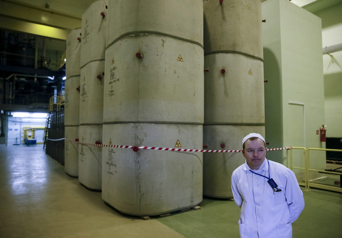An employee is seen at a plant for processing liquid radioactive waste at the Chernobyl nuclear power plant