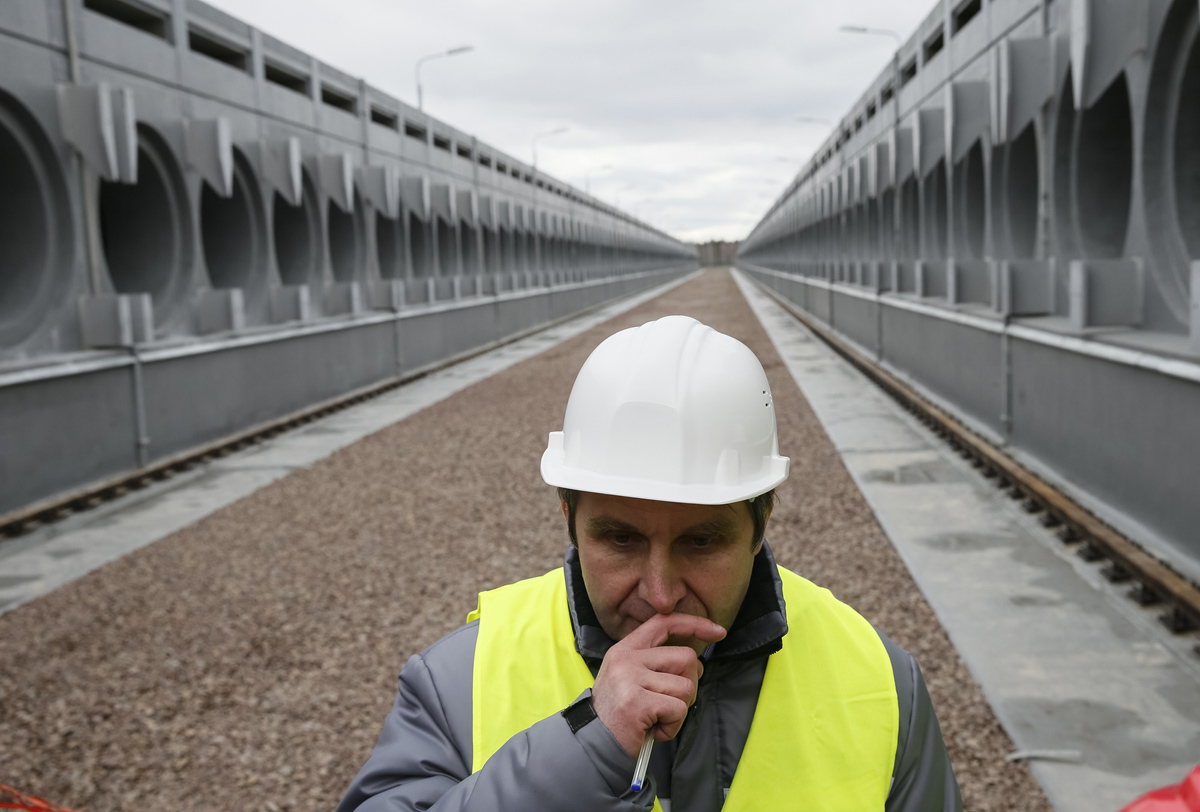 Worker is seen near dry spent nuclear fuel storage which is under construction at site of Chernobyl nuclear power plant